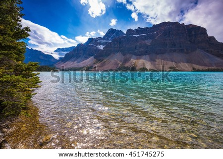Canadian Rockies, National park Banff. The amazing mountain glacial Bow Lake with water of emerald color - stock photo