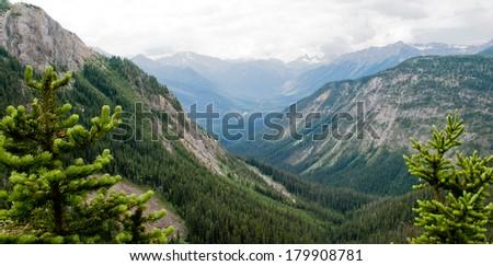 Canadian Rockies overlook between Alberta and British Columbia - stock photo