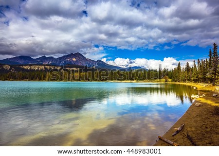 Canadian Rocky Mountains, Jasper National Park, lake Annette. The picturesque oval lake with clear water - stock photo