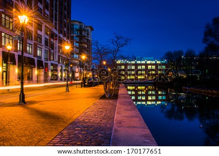 Canal along a street at night in Baltimore, Maryland. - stock photo