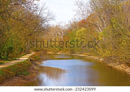 Canal along the north bank of the Potomac River at Georgetown, Washington DC. Trees along the canal in autumn foliage. - stock photo