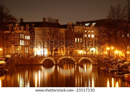 Canal and arch bridge at night;  Amsterdam, Netherlands