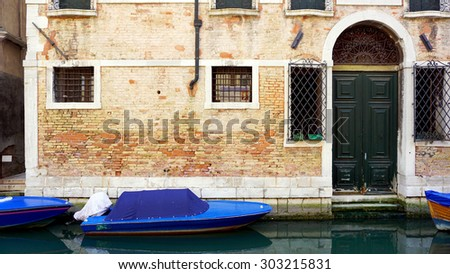 canal and boats with ancient brick wall house in Venice, Italy - stock photo