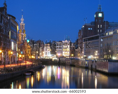 Canal and bridge in Amsterdam in the evening - stock photo