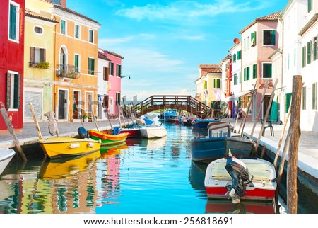 Canal and colorful houses in Burano, italy. - stock photo