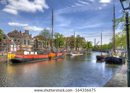 Canal and historical boats in Schiedam, Holland