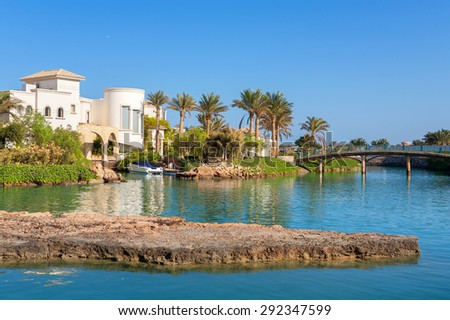 Canal and houses in resort of El Gouna. Egypt, North Africa - stock photo