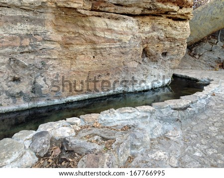 Canal from Montezuma Well in Montezuma Castle National Monument in Arizona - stock photo