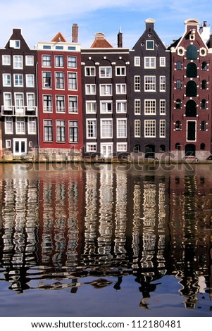 Canal houses of Amsterdam, The Netherlands with reflections - stock photo