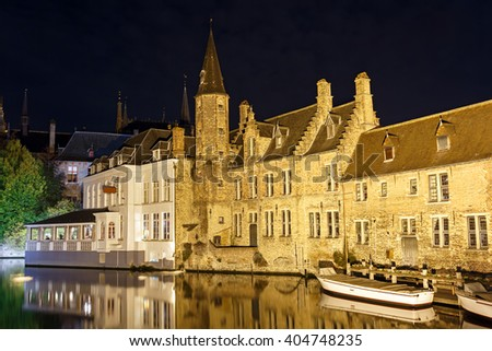 Canal in Bruges in the night. Belgium. / Night view from the promenade Rozenhoedkaai along the canal in the center of medieval city Bruges, Belgium. - stock photo