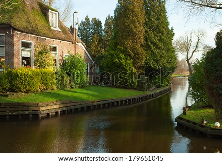 Canal in Giethoorn. Giethoorn is a village in the Dutch province of Overijssel.