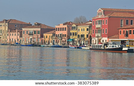 Canal in the middle of the Island of Murano in the Venice Lagoon, famous for its historical glass making - stock photo