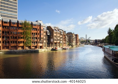 canal in town with houses and apartments. waterside in bristol in england - stock photo