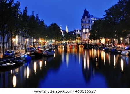 Canal of Amsterdam at night, Netherlands, Europe