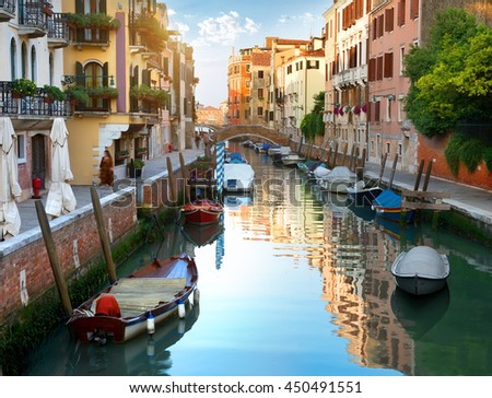 Canal of Venice and boats, Italy - stock photo