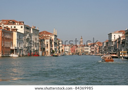 canal of venice with houses and gondola, italy, europe