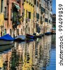 Canal reflections and old buildings in Venice, Italy - stock photo