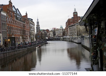 Canal street in the center of Amsterdam on an early spring morning - stock photo