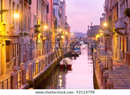 Canal street in Venice, Italy on sunset