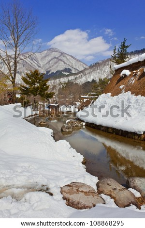 Canal Surrounded with Snow at Gassho-zukuri Village/Shirakawago - stock photo