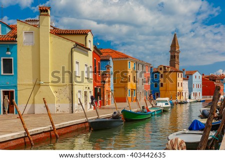 Canal with colorful houses and church on the famous island Burano, Venice, Italy - stock photo