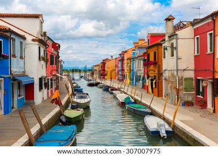Canal with colorful houses on the famous island Burano, Venice, Italy - stock photo