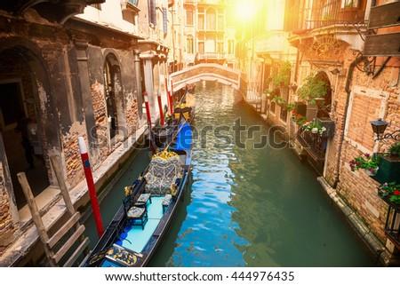 Canal with gondola in Venice, Italy - stock photo