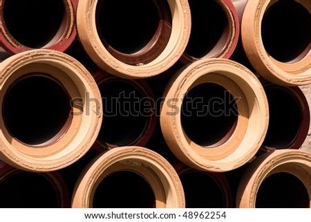 canalization globular gray iron drainpipe - stock photo