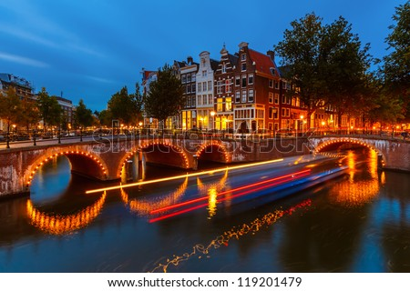 Canals in Amsterdam at night - stock photo