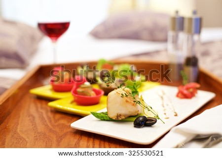 Canap���© appetizer in bed in luxury hotel