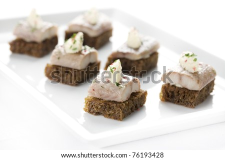 canapés, herring, seafood, food, snacks, restaurant, butter, bread - stock photo