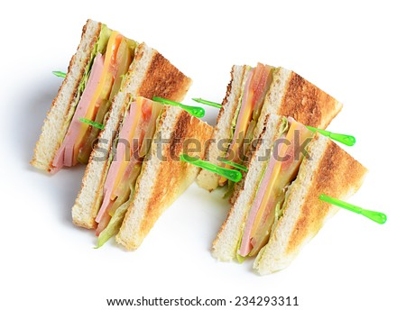 Canape from bread with sausage and cucumber - stock photo