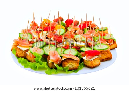 Canape on a dish on a white background - stock photo