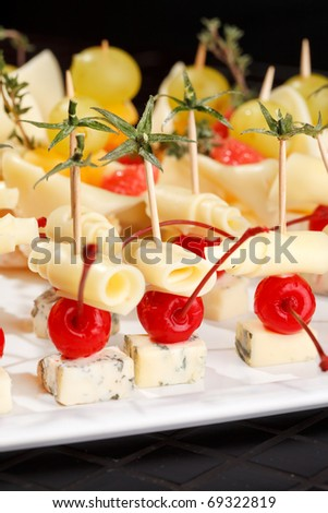 canape on the plate - stock photo
