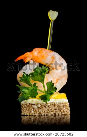 canape with boiled shrimp, isolated on black - stock photo