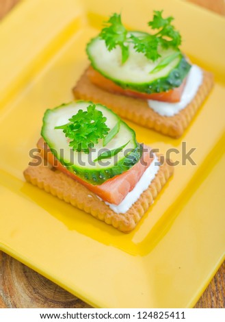 canape with cucumber and salmon - stock photo