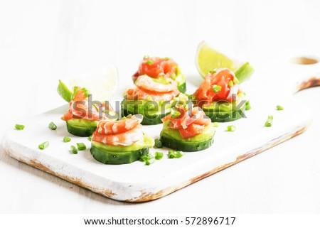 canape cucumber avocado mousse salmon shrimp stock photo royalty free 572896717 shutterstock. Black Bedroom Furniture Sets. Home Design Ideas