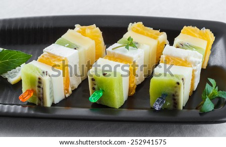 canape with fruits and cheese - stock photo