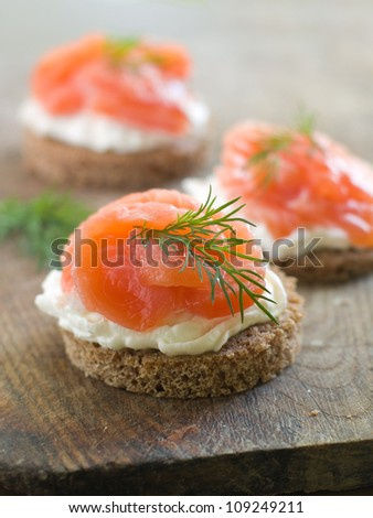 Canape with  salmon and dill for party, selective focus - stock photo
