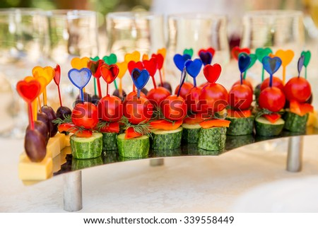 Canape with tomatoes and cucumbers for party food - stock photo
