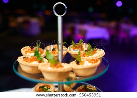 Canapes caviar on table restaurant stock photo 550453942 for Restaurant canape