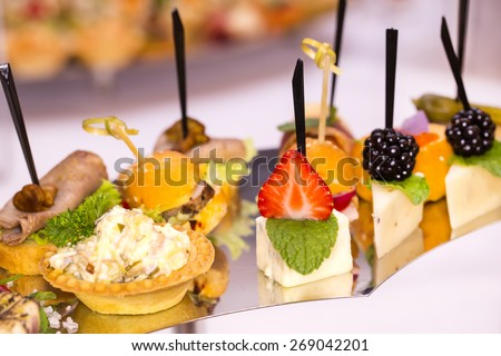 Canapes of cheese vegetables meat and seafood  - stock photo