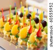 Canapes of cheese with fruits, close-up shot - stock photo