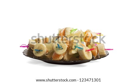 Canapes of fruit on a white background isolated