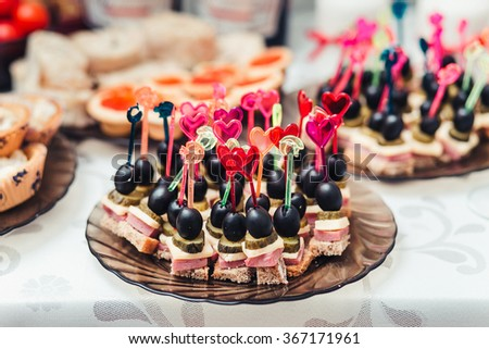 Canapes on plate buffet closeup - stock photo