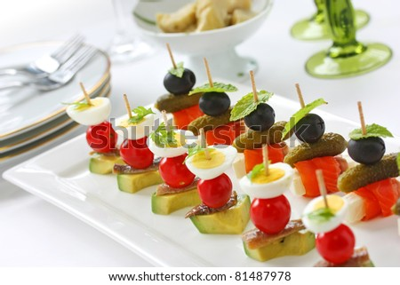 canapes on toothpicks , appetizer, pinchos , spanish food