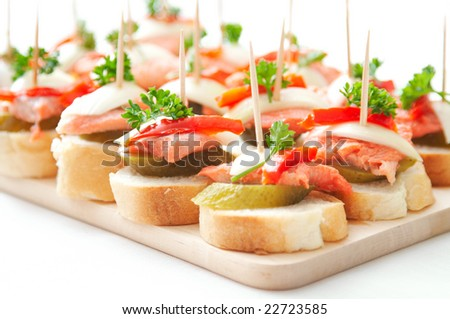 canapes with fish - stock photo