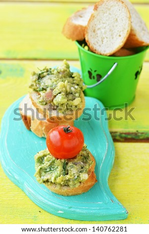 canapes with guacamole,salmon and cherry tomatos