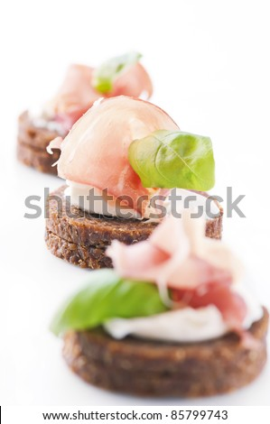 canapes with ham and cream cheese - stock photo