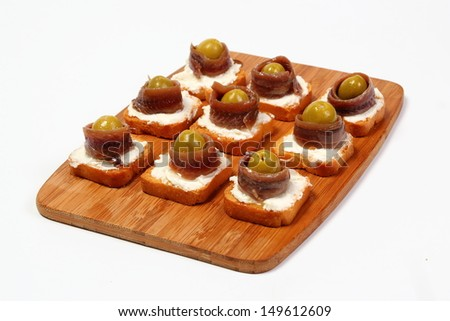 Canapes with pickled anchovy fillet